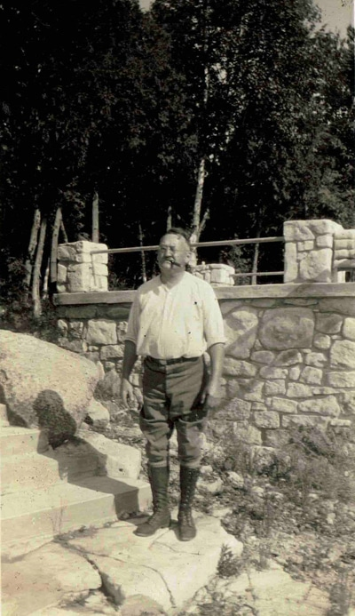 R.W. Peterson near his boathouse on White Cliff Road.